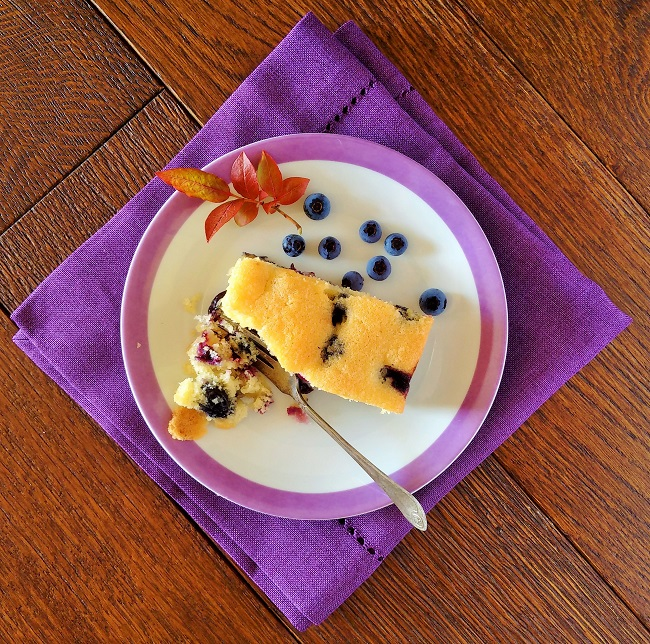 Ready_to_serve_slice_of_blueberry_cake_with_fresh_berries