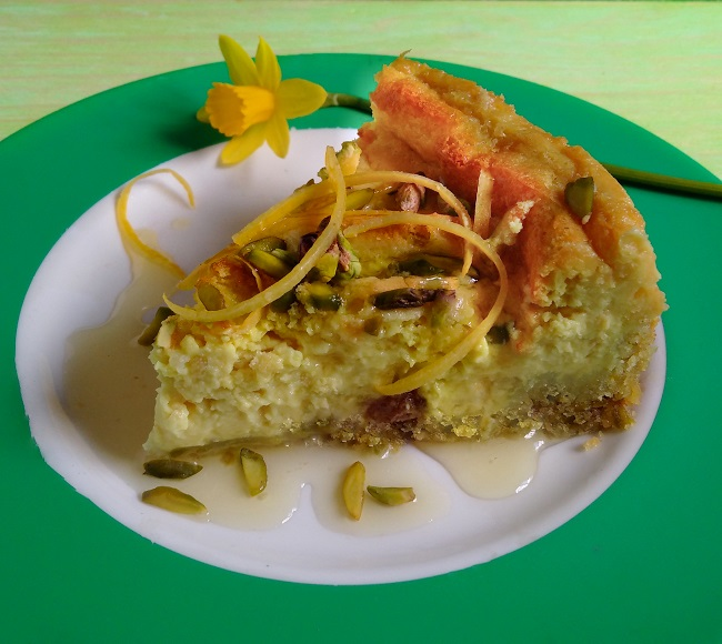 Serving_of_baked_vegan_cheesecake_with_lemon_syrup