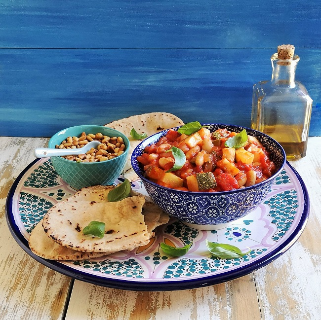 Mediterranean-style_setting_with_bowl_of_courgette_and_white_bean_salad