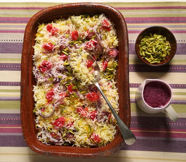 Serving_dish_of_cooked_rice_with_sour_cherries
