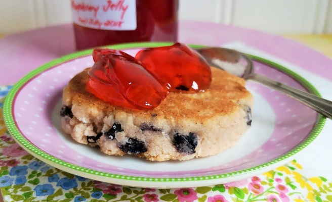 2_spoonfuls_of_rhubarb_and_raspberry_jelly_served_on_a_Welsh_cake