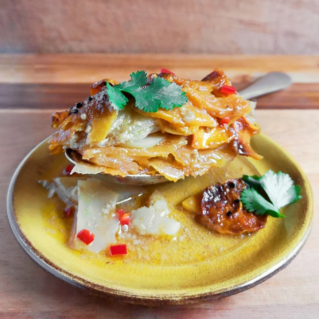 A_spoonful_of_sliced_of_swede, sweet potato_and_potato_cooked_in_coconut_milk_and_curry_powder