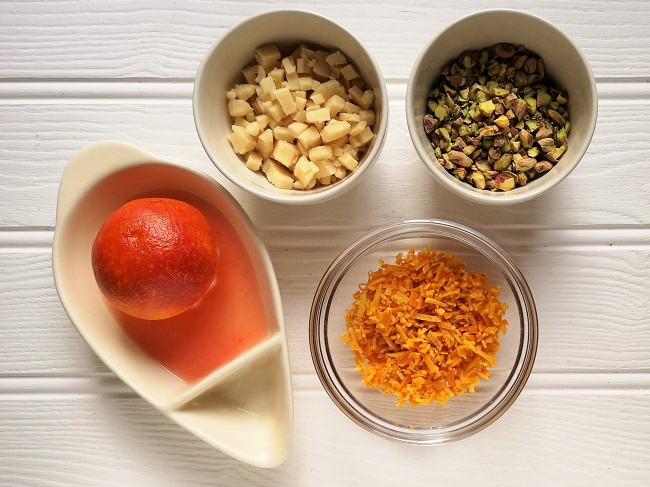 Red_orange_juice_and_rind_chopped_marzipan_and_shelled_pistachios