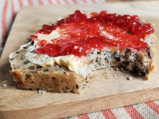 Slice_of_gluten-free_bread_spreadwith_dairy_free_margarine_and_raspberry_jam