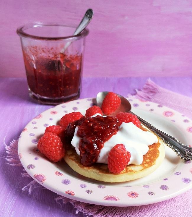 Small_pancake_with_coconut_yogurt_raspberries_and_a_generous_spoonful_of_reduced_sugar_raspberry_jam