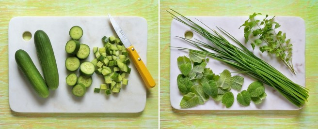 Mini_Munch_cucumbers_mint_leaves, fresh_chives_and_sprigs_of_salad_burnet_on_a_marble_chopping_board