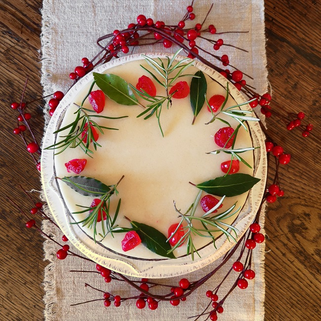 Overhead_image_of_a_marzipanned_vegan_fruit_cake_decorated_simply_for_Christmas