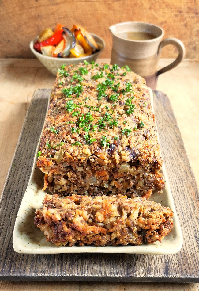 Whole_nutloaf_with_slice_on_board_with_roast_veg_and_gravy