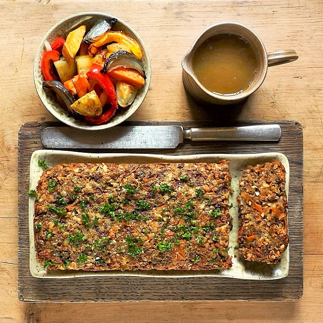 Overhead_image_of_homemade_nut_loaf_with_a_bow_of_roast_vegetables_and_vegetable_gravy