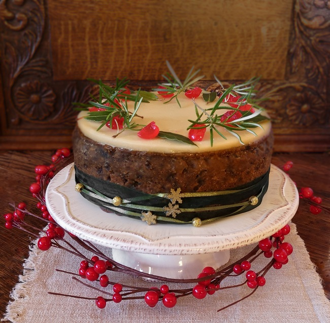 Vegan_gluten-free_fruit_cake_topped_with_marzipan_decorated_for_Christmas