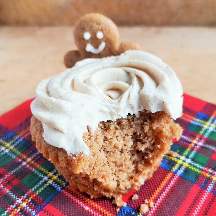 Bite-out_of_gingerbread_cupcake_with_mini_gingerbread_man