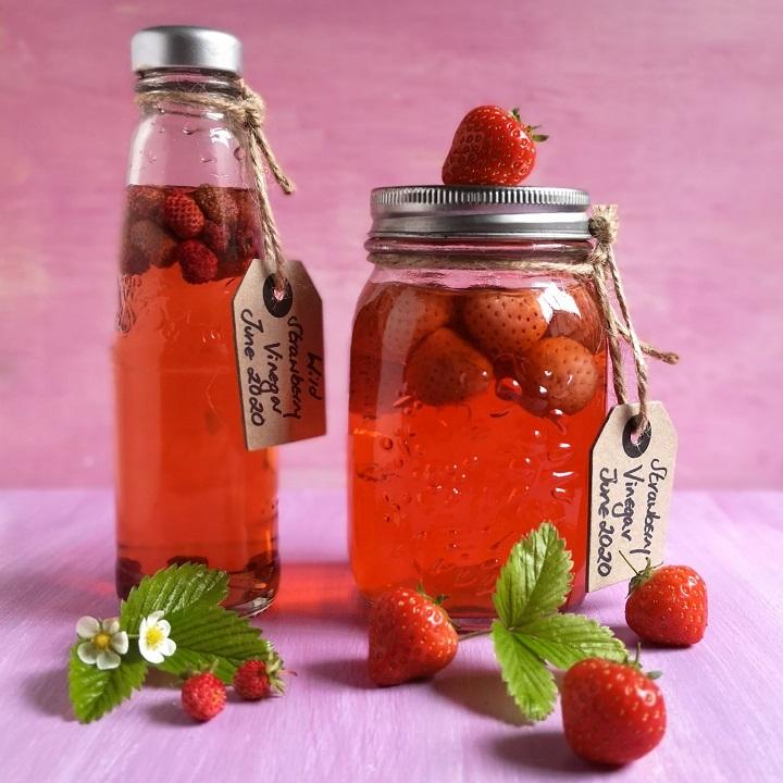 Bottle_of_wild_strawberry_vinegar_alongside_a_jar_of_fresh_strawberry_vinegar
