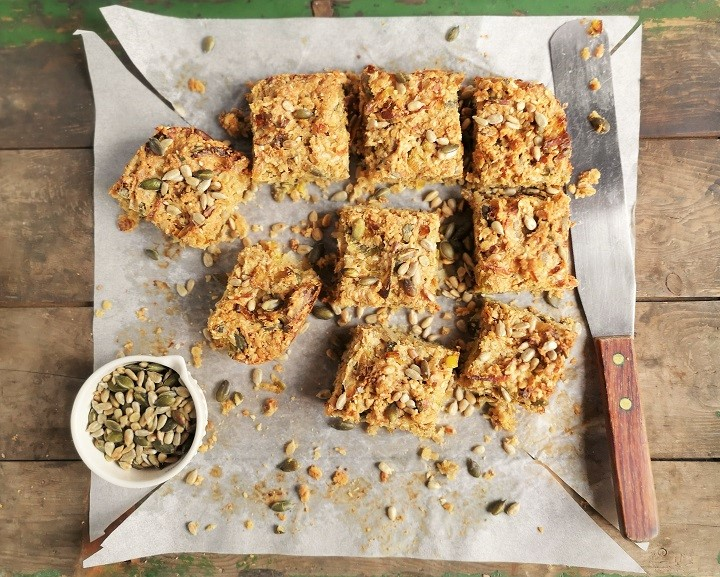 Overhead_image_of_freshly_cut_savoury_flapjack_with_toasted_seeds